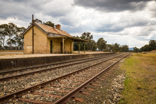 Rural train platform with old railway house