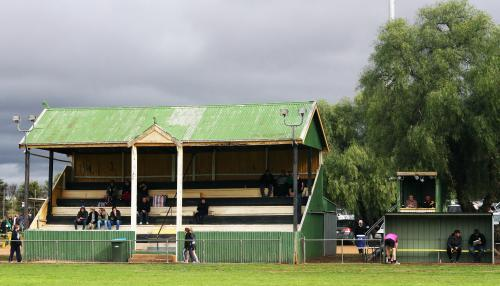 Rustic green grandstand at Wirrabara Oval on overcast day