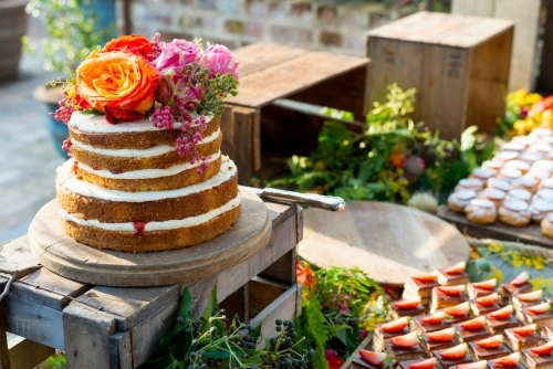 Rustic sponge cake at birthday with flowers