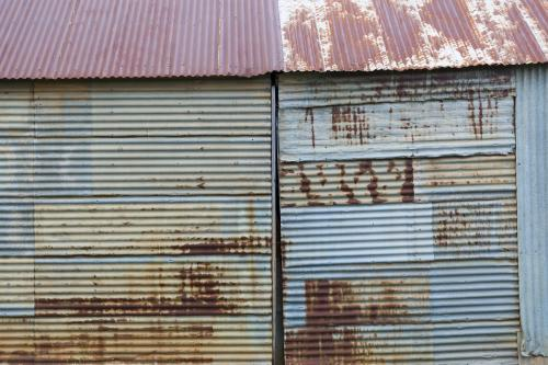 Rusty corrugated iron wall of rural shed