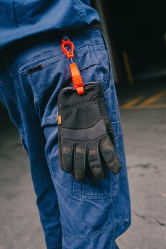 Safety work pants with black gloves