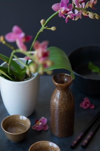 Sake bottle and cups with orchids