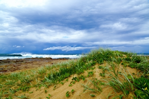 A stormy sky over the dunes and ocean at Sandon Point, Bulli, NSW