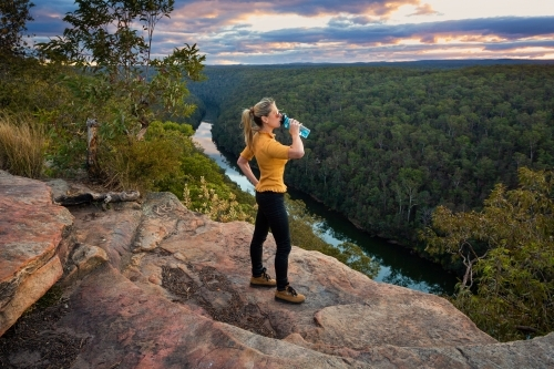 Scenic views bushwalking through Blue Mountains Australia arriving at a  rocky outcrop with views ov