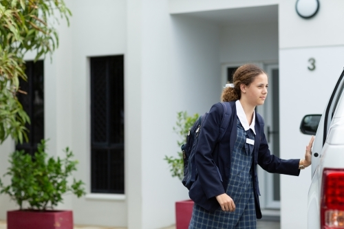 Schoolgirl arrives home in school uniform