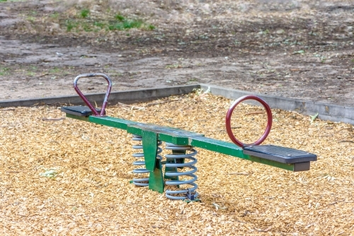 Seesaw in playground in the park no children