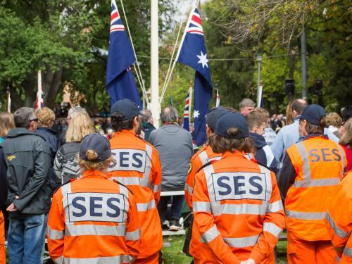 SES in orange suits attending ANZAC Day ceremony