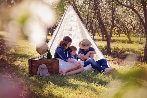 Siblings Sharing in a Lace Teepee