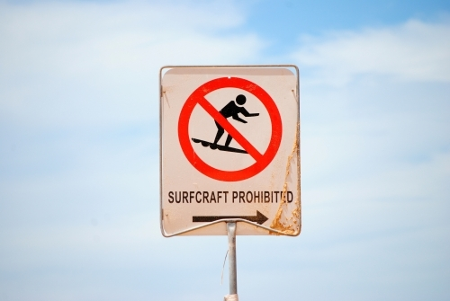 Sign at the beach proclaiming Surfcraft Prohibited