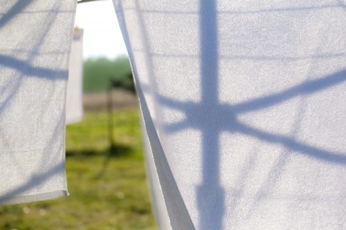 silhouette of a hills hoist washing line against washing