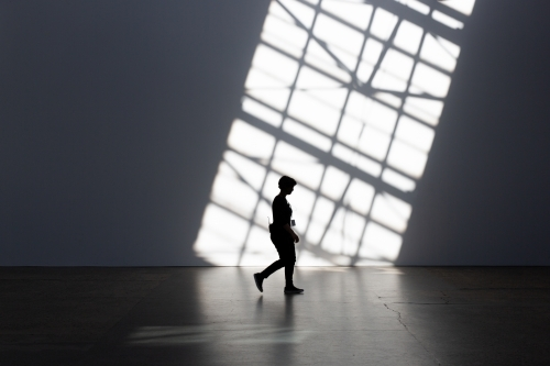 Silhouette of person and shadows at Carriage Works, Sydney