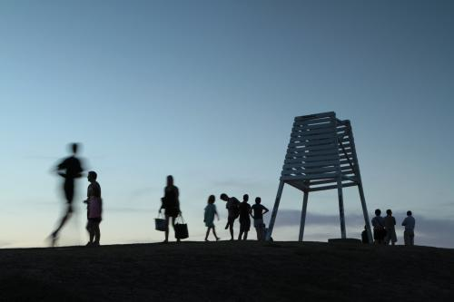 Silhouettes of people on a hilltop at dusk