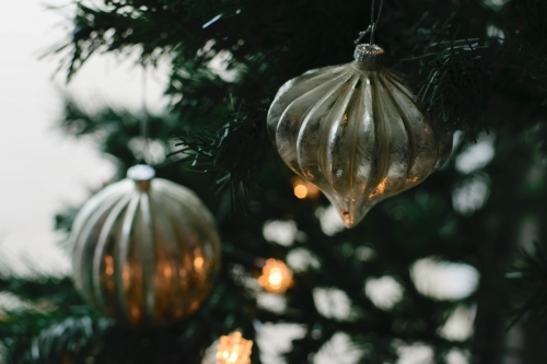 Silver Glass Baubles on Christmas Tree with lights