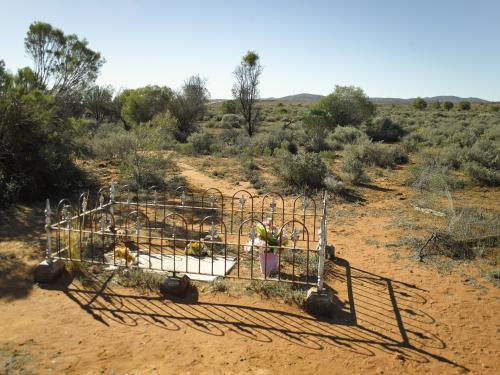 Fenced grave in the outback on a sunny day