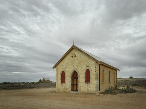 Old church and buildings in outback against a dramatic sky