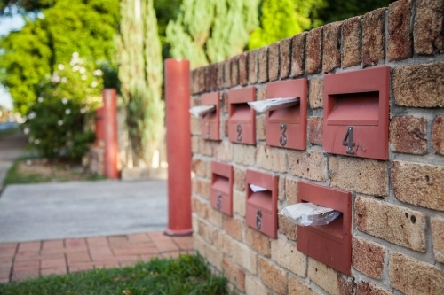 Urban mailboxes in brick wall
