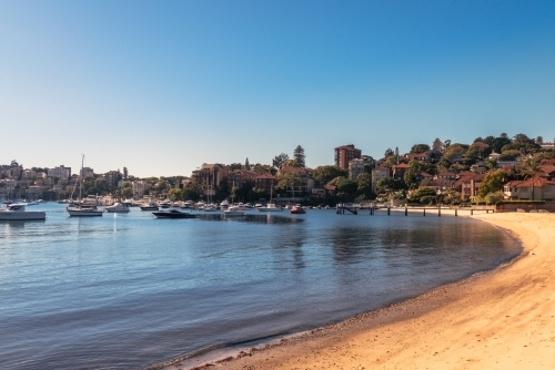 Small beach with boats in Sydney's eastern suburbs