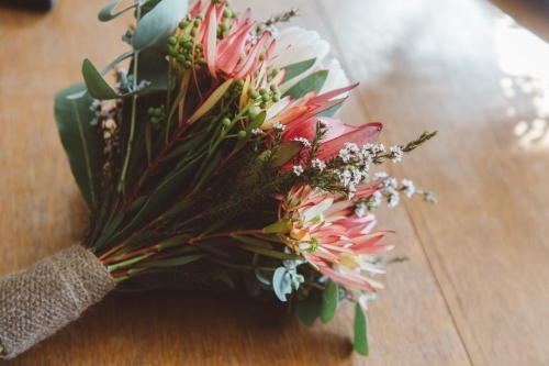 Small posy of native flowers, sitting on a wooden table
