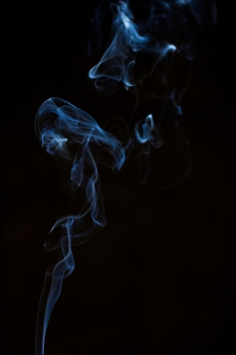 smoke suspended in darkness