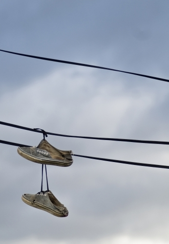 Sneakers hanging off electrical wires
