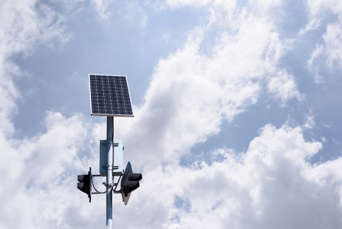 Solar panel powered traffic light against blue sky background, clean energy in use, in Melbourne