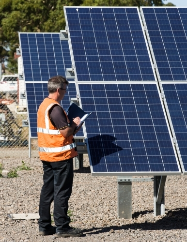 Employee taking notes at Solar Panel plant