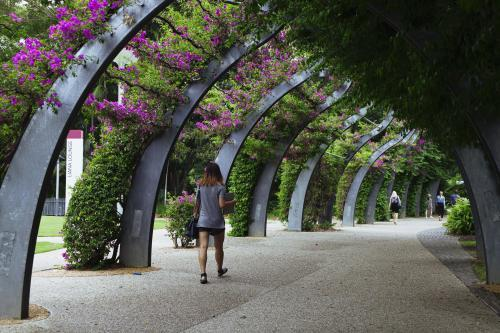 Girl walking beneath the Arbour at South Bank, Brisbane