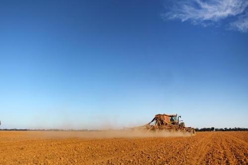 Sowing a crop in early morning light