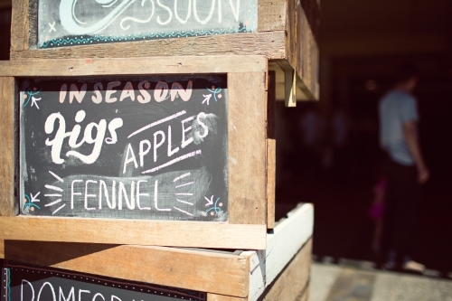 Stacked wooden crates with chalkboard signs