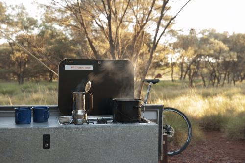 steaming coffee pot at bush campsite