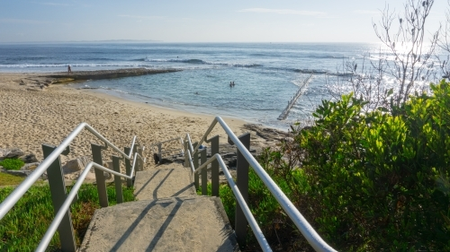 Steps and handrails leading down to beach and Oak Park ocean pool
