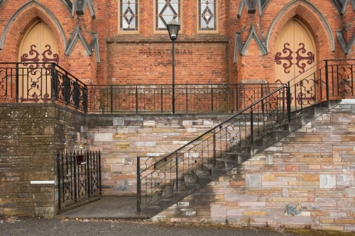 steps and wrought iron railing at entrance of a regional church