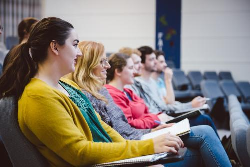 Young adult students in a university lecture hall
