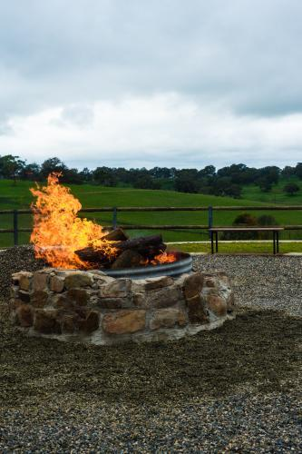 Stone outdoor fire pit with blazing fire