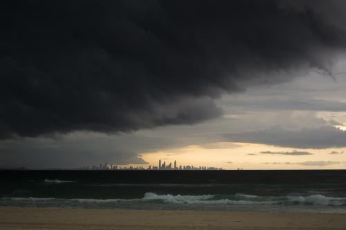 Storm clouds over sea with Gold Coast building in the distance