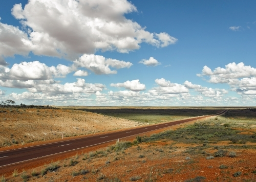 Long straight highway and landscape in outback