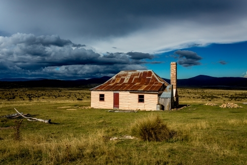 Sunlight and storms at an old hut in Snowy Mountains, Kosciuszko National Park