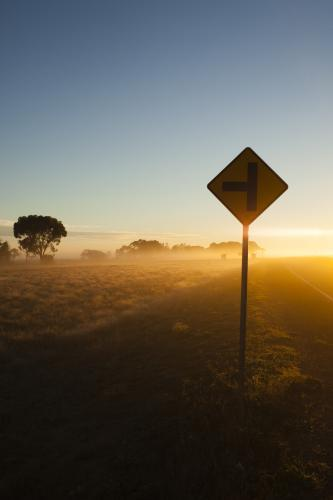 Sunrise in regional highway with Sign in the foreground