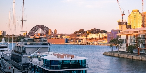 sunset at Pyrmont Bay wharf, with the Harbour Bridge at the horizon