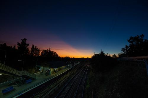 Sunset over a train station