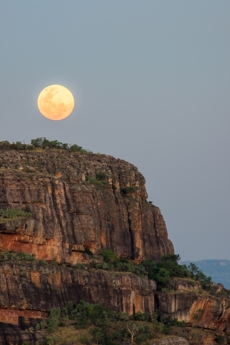 Super moon rising over Nourlangie rock