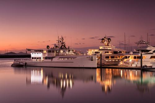 Superyachts at Abell Point Marina during twilight.