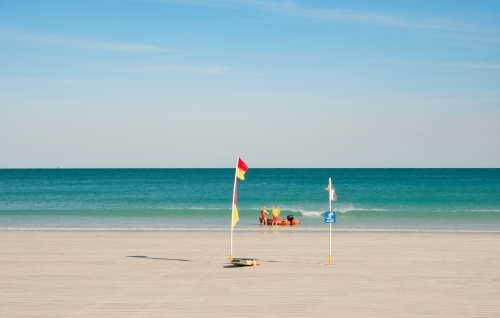 Surf Lifesavers Launching Rubber Dinghy in Cable Beach