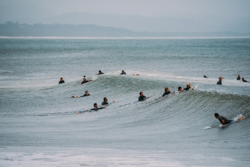 Surfers waiting for waves in the ocean