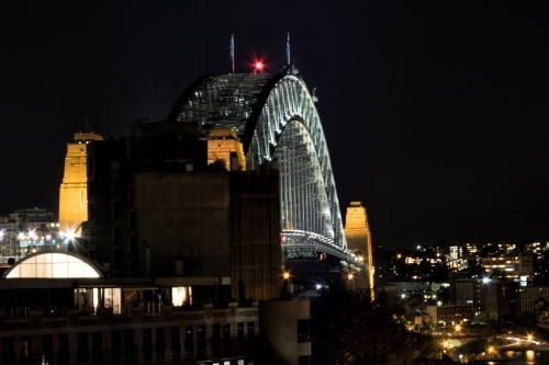 Sydney Harbour Bridge at night with city lights