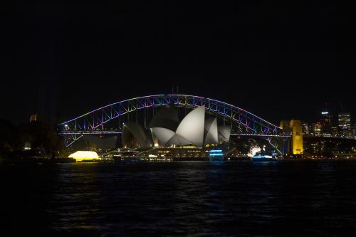 Sydney harbour in darkness with opera house and bridge