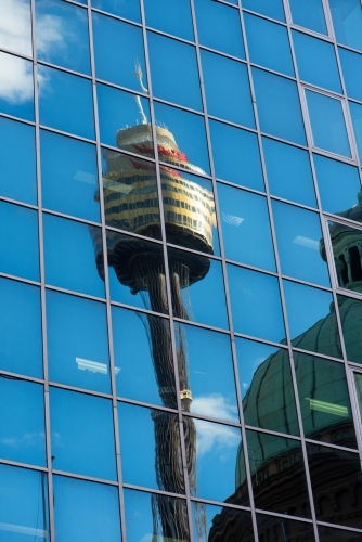 Sydney tower reflected in the windows of an office building