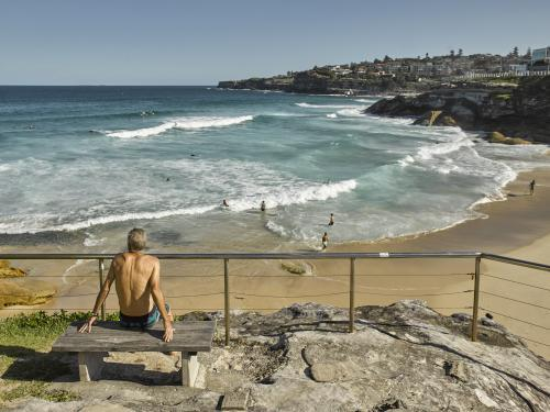 man looking out over Tamarama beach