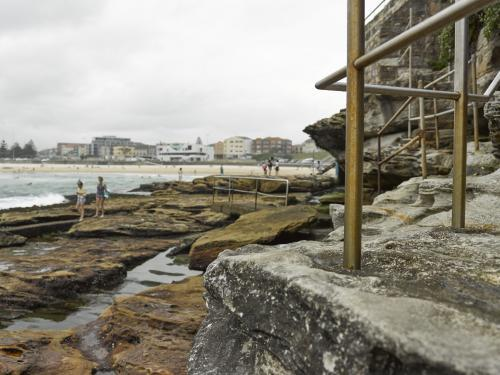 Walking track over rocks at Bondi on an overcast day