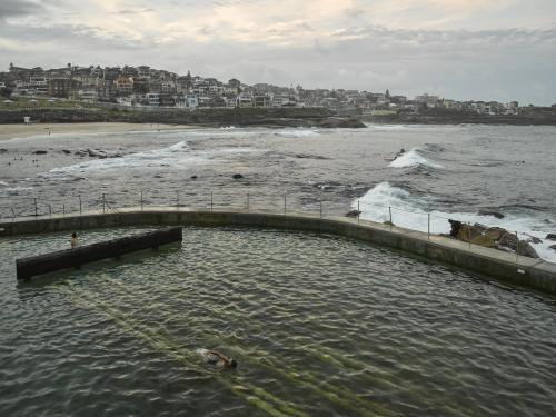 Swimmers at Bronte Ocean Pool on an overcast day